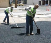 workers maintaining asphalt streets